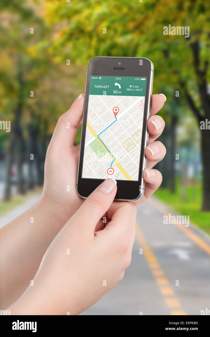 Female hands holding black mobile smart phone with map gps navigation application with planned route on the screen. - Stock Image