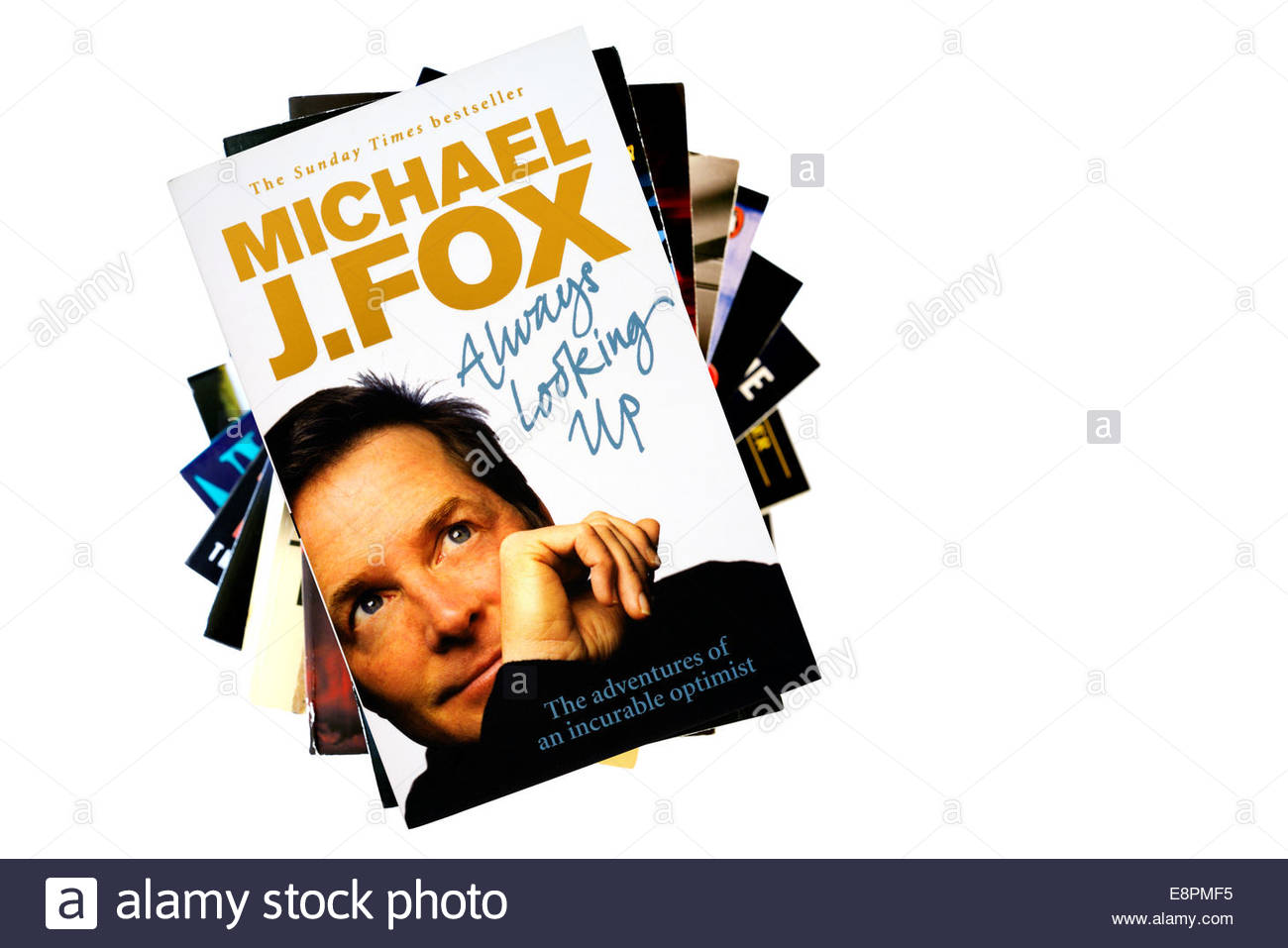 Michael J Fox autobiography Always Looking Up, stacked used books, England - Stock Image