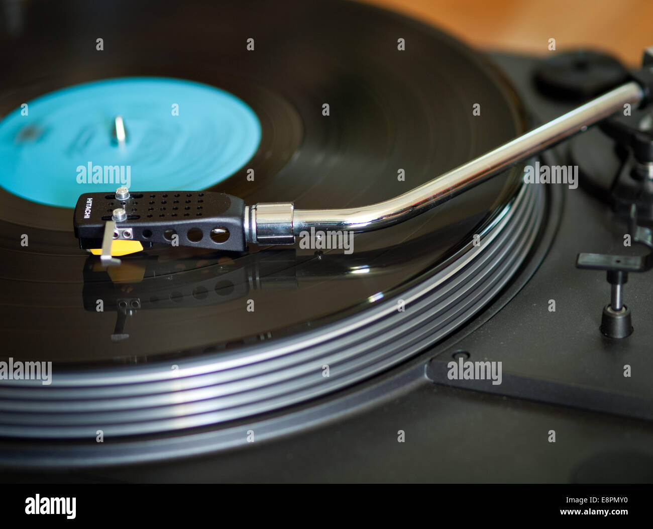 A vinyl record spins on a vintage, late 1970's Hitachi HT-350 turntable record player. - Stock Image