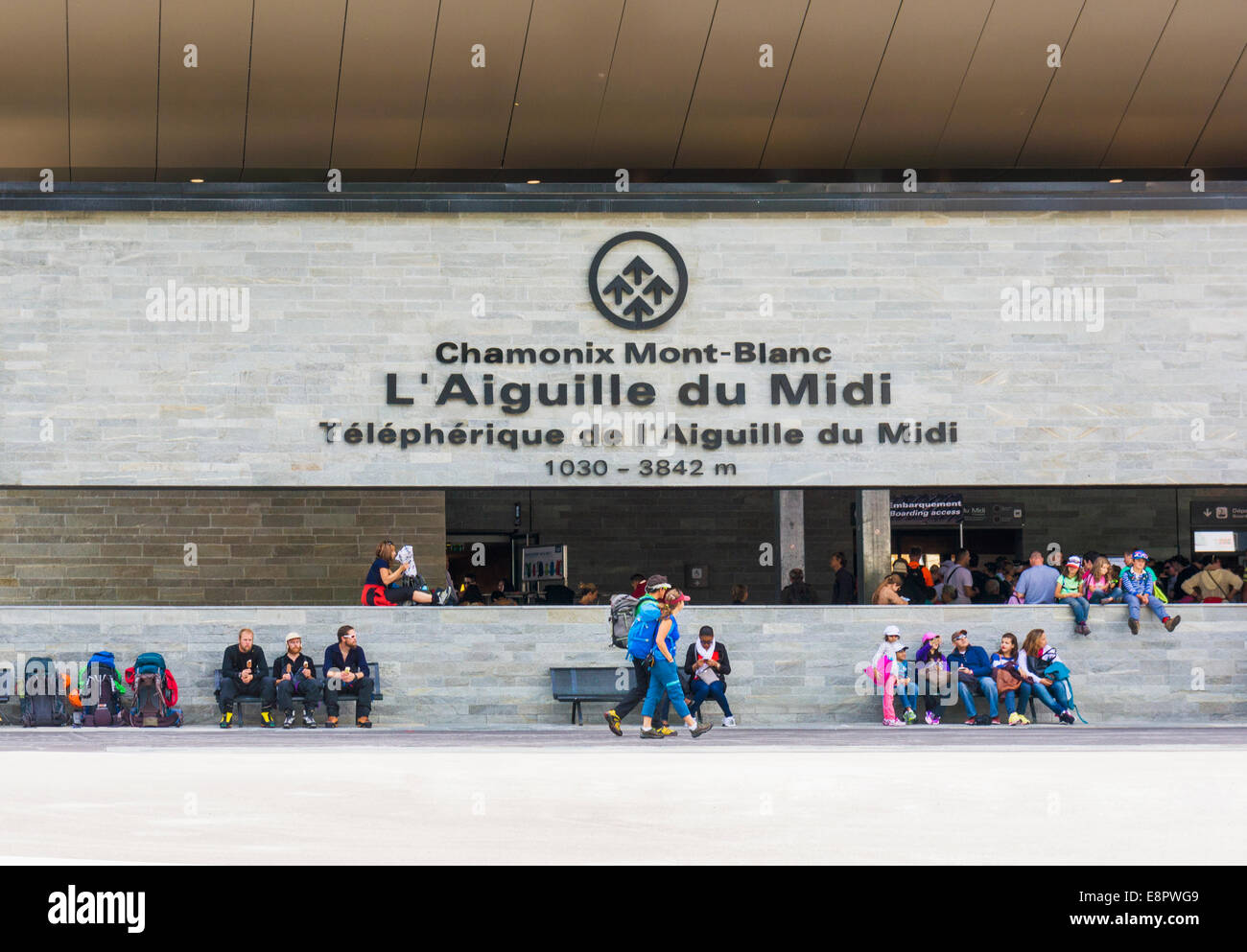 Climbers and tourists outside the Aiguille du Midi cable car station in Chamonix, French Alps, France, Europe - Stock Image