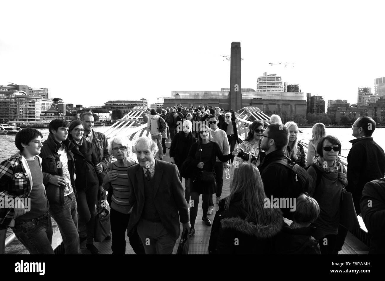London UK October 2014 - Visitors crowd across the Millennium footbridge across the River Thames - Stock Image