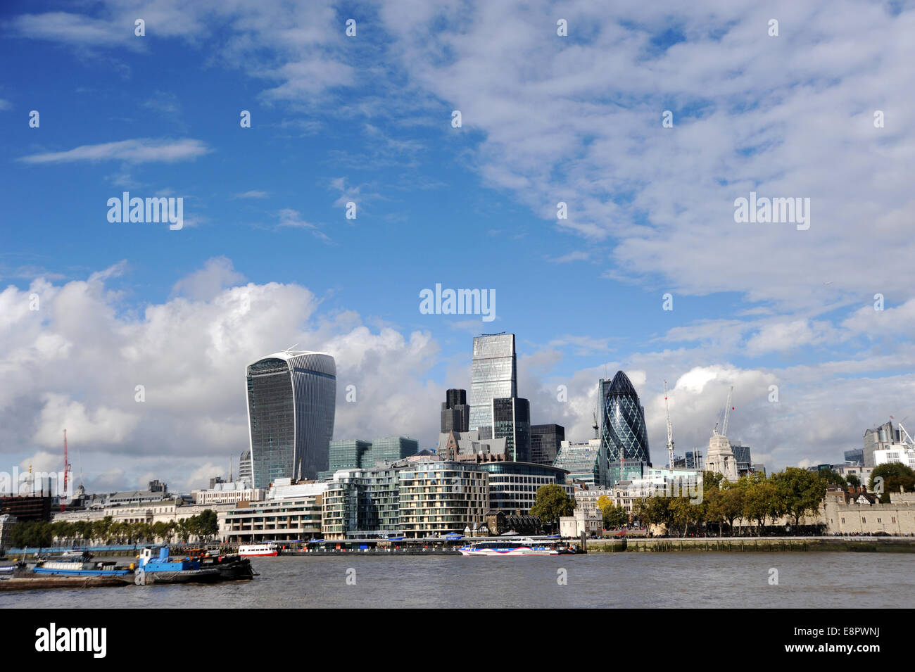View across the River Thames towards the city in London showing buildings known as the walkie talkie (left) the - Stock Image