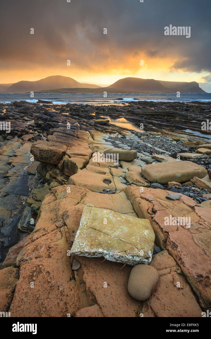 Sunset captured from Warebeth on Mainland Orkney with the hills of Hoy in the distance. Stock Photo