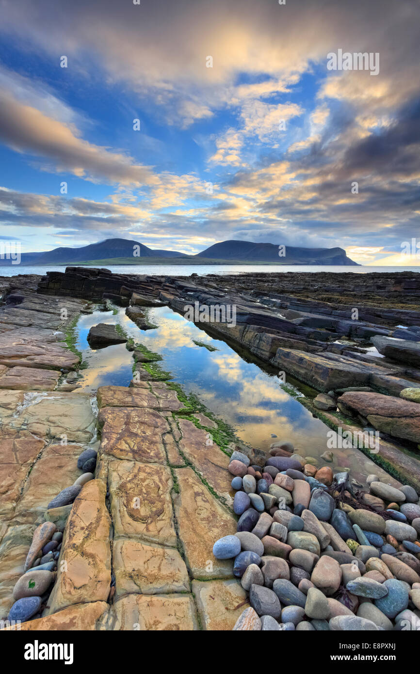 Sunset captured from Warebeth on Mainland Orkney with the hills of Hoy in the distance. - Stock Image