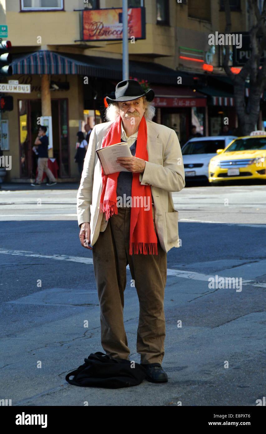 social activist and poet Jack Hirschman hichikes in North Beach San Francisco - Stock Image