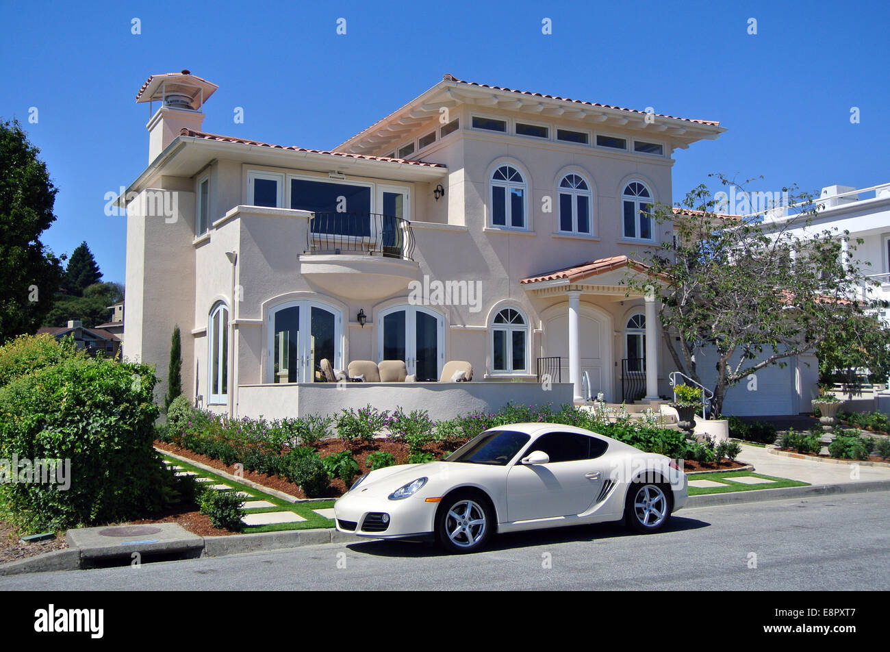 luxury sports car parked in front of luxury Bay front home in Mill Valley California Stock Photo