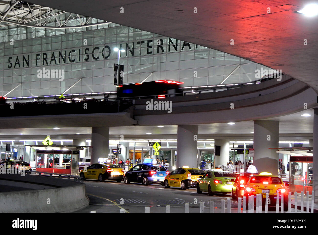taxicabs line up at arrivals terminals at San Francisco International airport - Stock Image