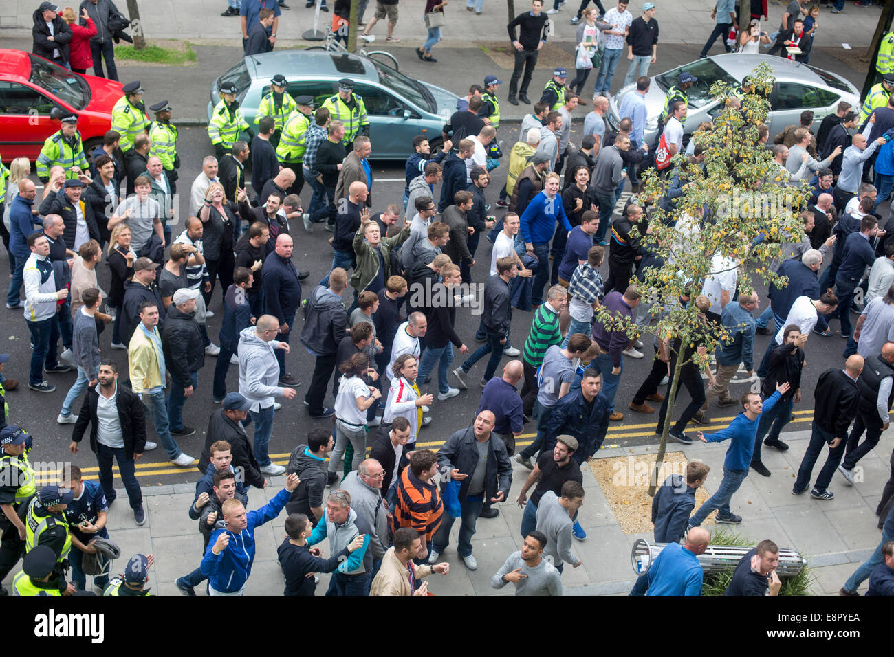 Spurs fans escorted police derby match Arsenal crowd - Stock Image