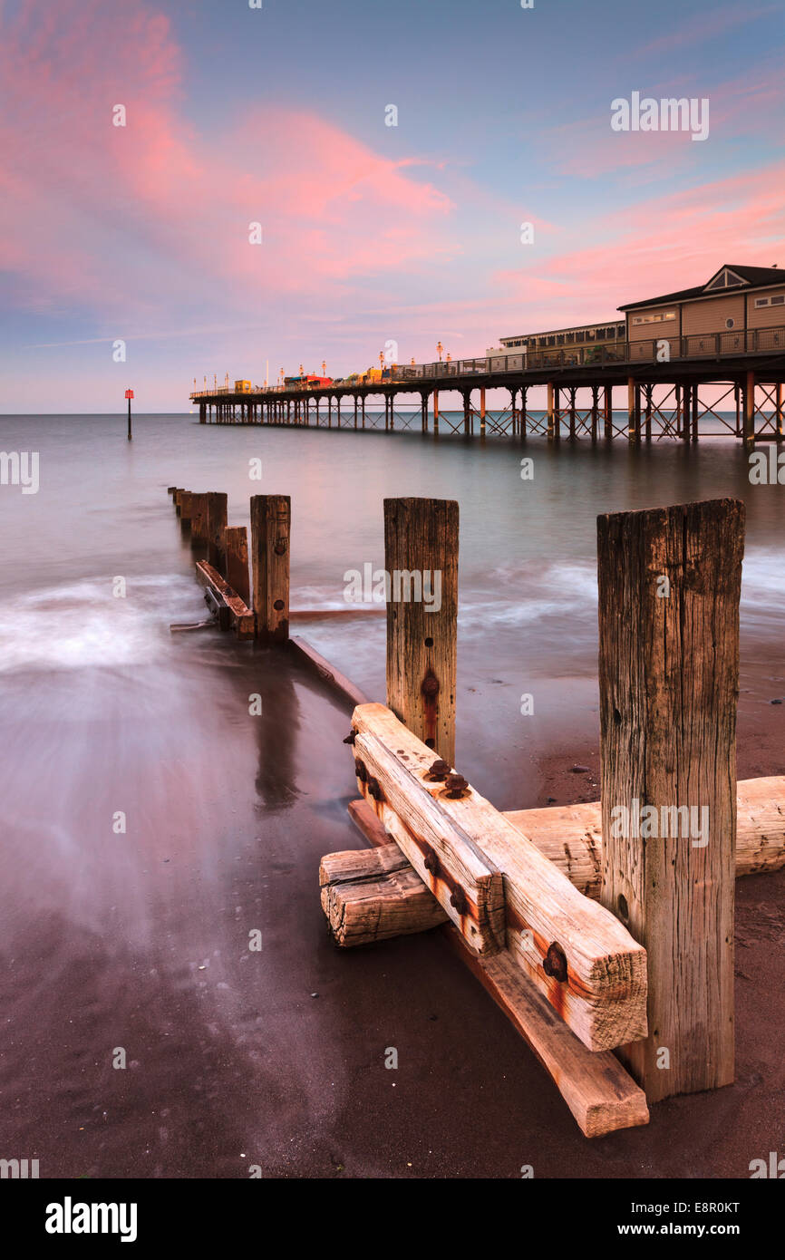 Teignmouth Pier captured at sunset. - Stock Image