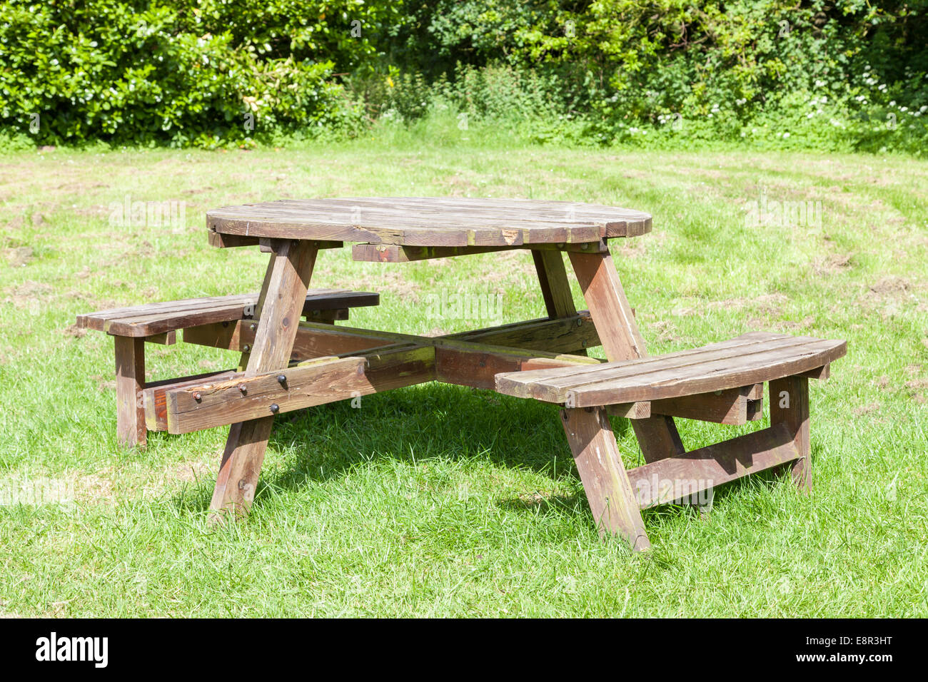 Round Wooden Picnic Table And Seating On Grass In A Country Park Stock Photo Alamy
