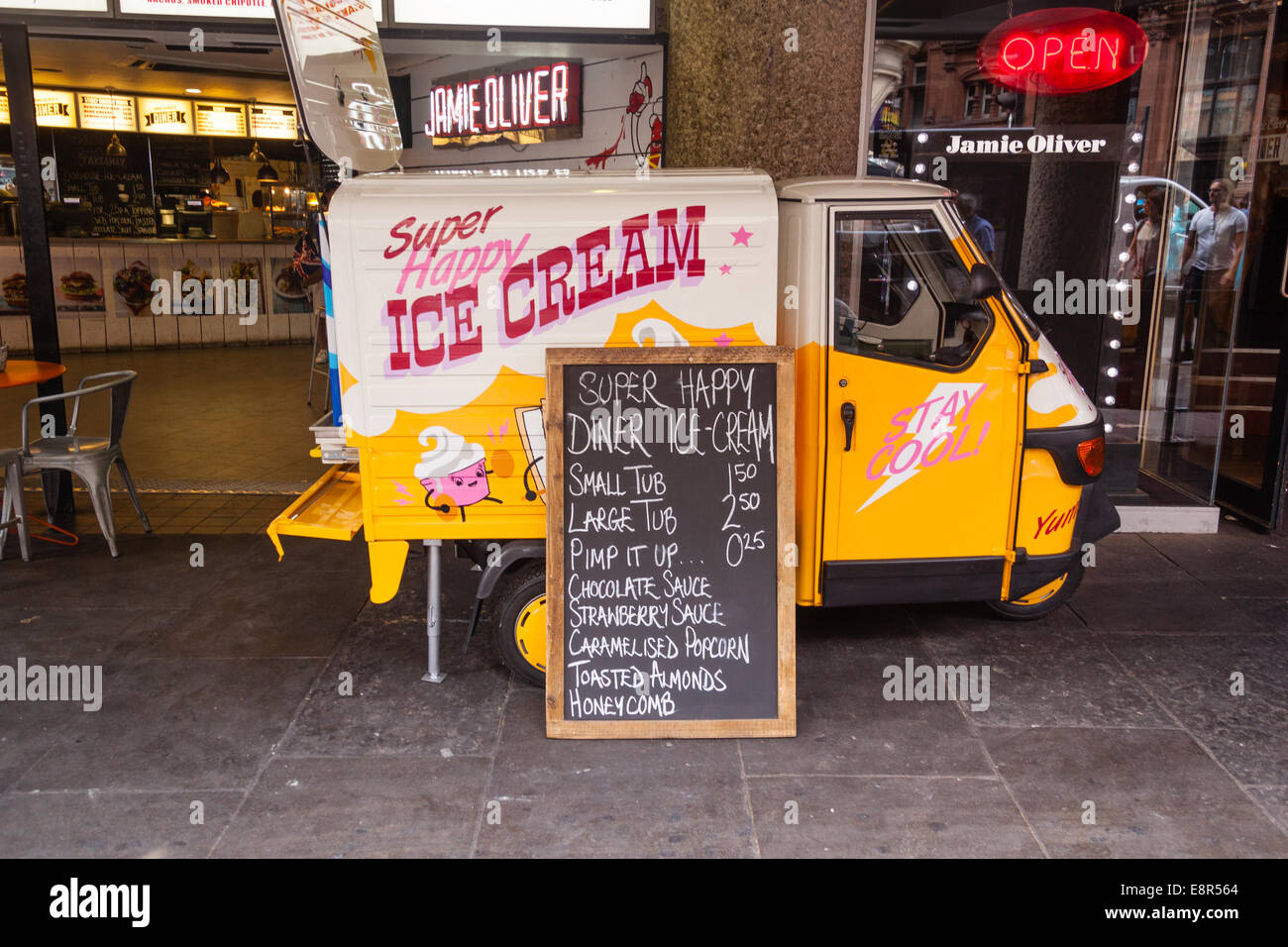 Vespa Piaggio ape ice cream truck, Shaftesbury avenue, London, England, United Kingdom. - Stock Image