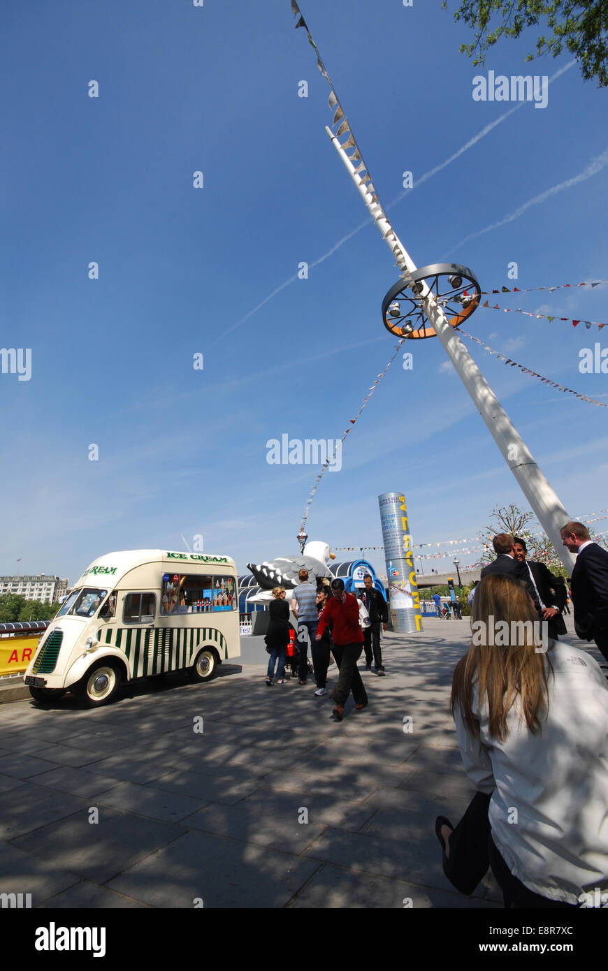 icecream van and tourists at London's South Bank United Kingdom - Stock Image