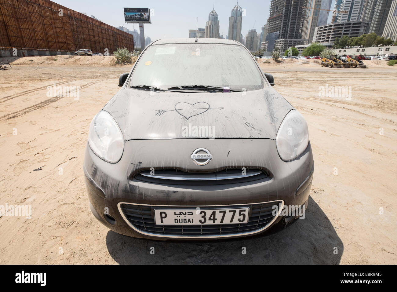 sand covered abandoned car in a car parking lot  in Dubai United Arab Emirates - Stock Image