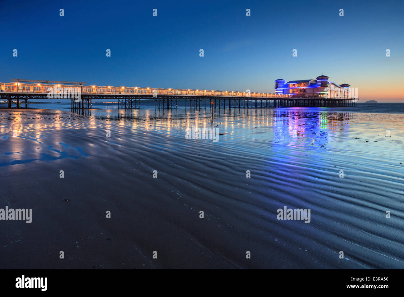 The rebuilt Grand Pier at Weston-Super-Mare captured about 45 minutes after sunset. - Stock Image