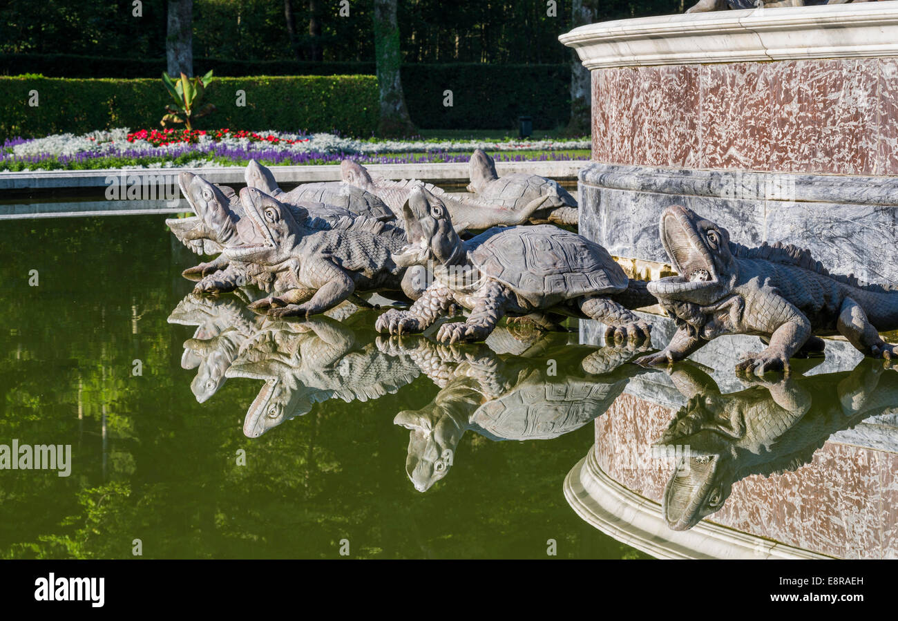 Herrenchiemsee Palace on an island in lake Chiemsee, water games with the Latona fountain and western facade, Bavaria, - Stock Image