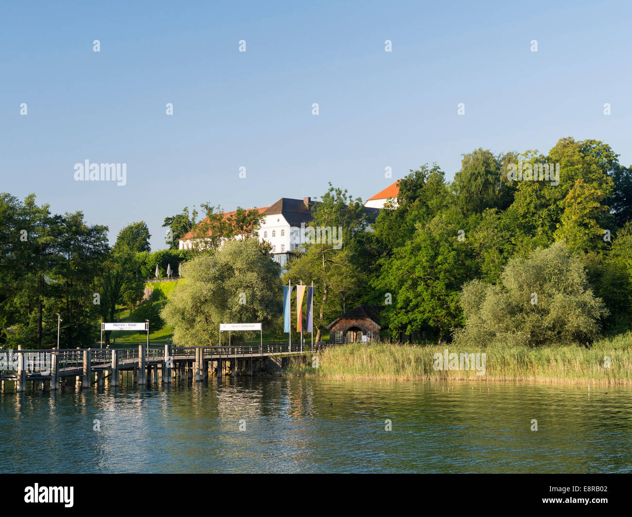 Herreninsel, jetty for the excursion boats bringing visitors to Herrenchiemsee Palace, Bavaria, Germany. - Stock Image