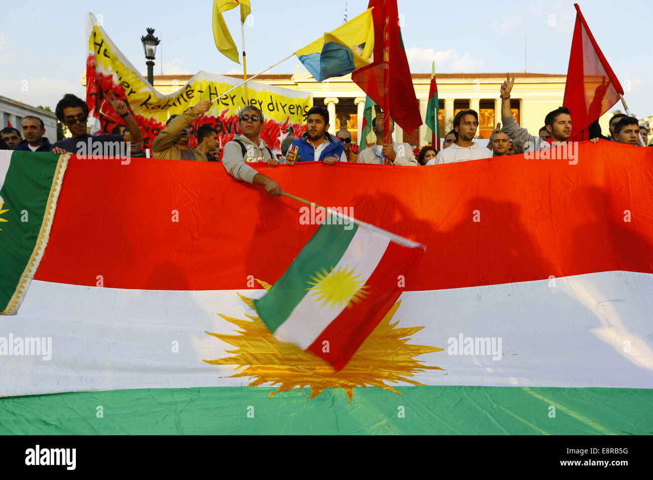 Athens, Greece. 13th October 2014. Protesters wave a Kurdish flag. Kurds living in Greece protested against the - Stock Image