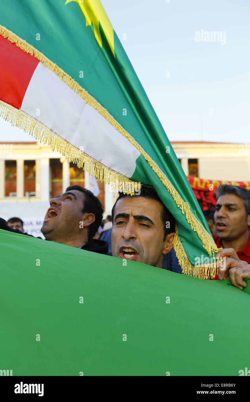 Athens, Greece. 13th October 2014. A protester is covered in a Kurdish flag. Kurds living in Greece protested against - Stock Image