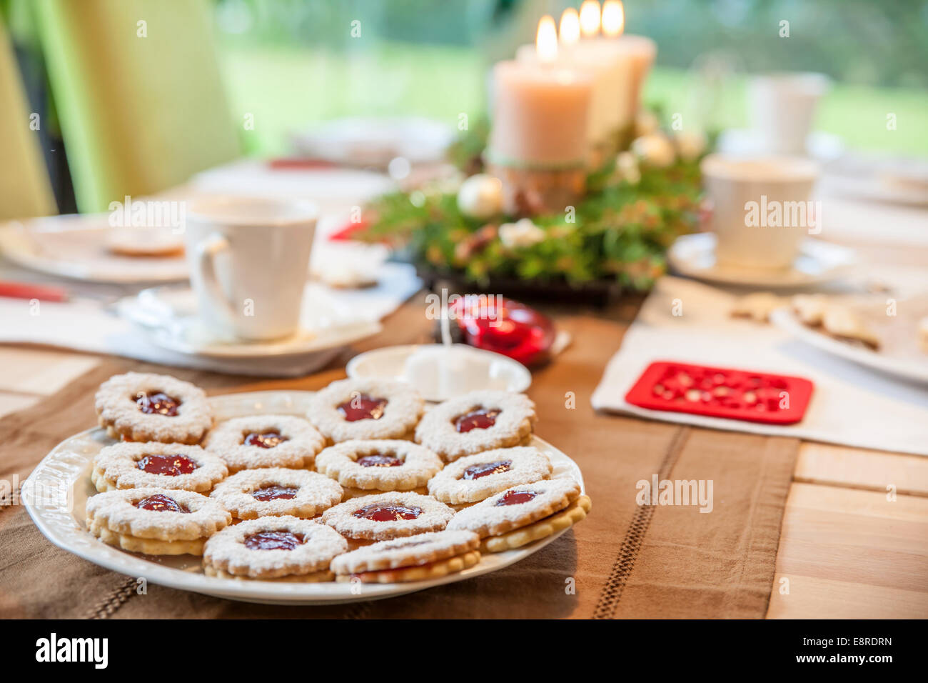 Coffee table with Advent wreath and Christmas cookies - Stock Image