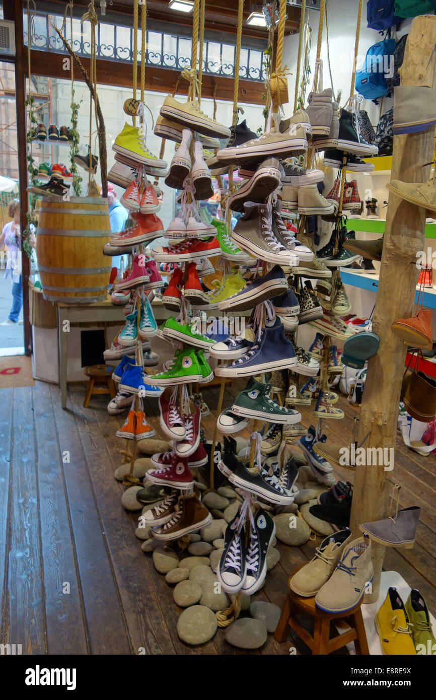 Shop display of Converse shoes, in Lucca, Italy. - Stock Image