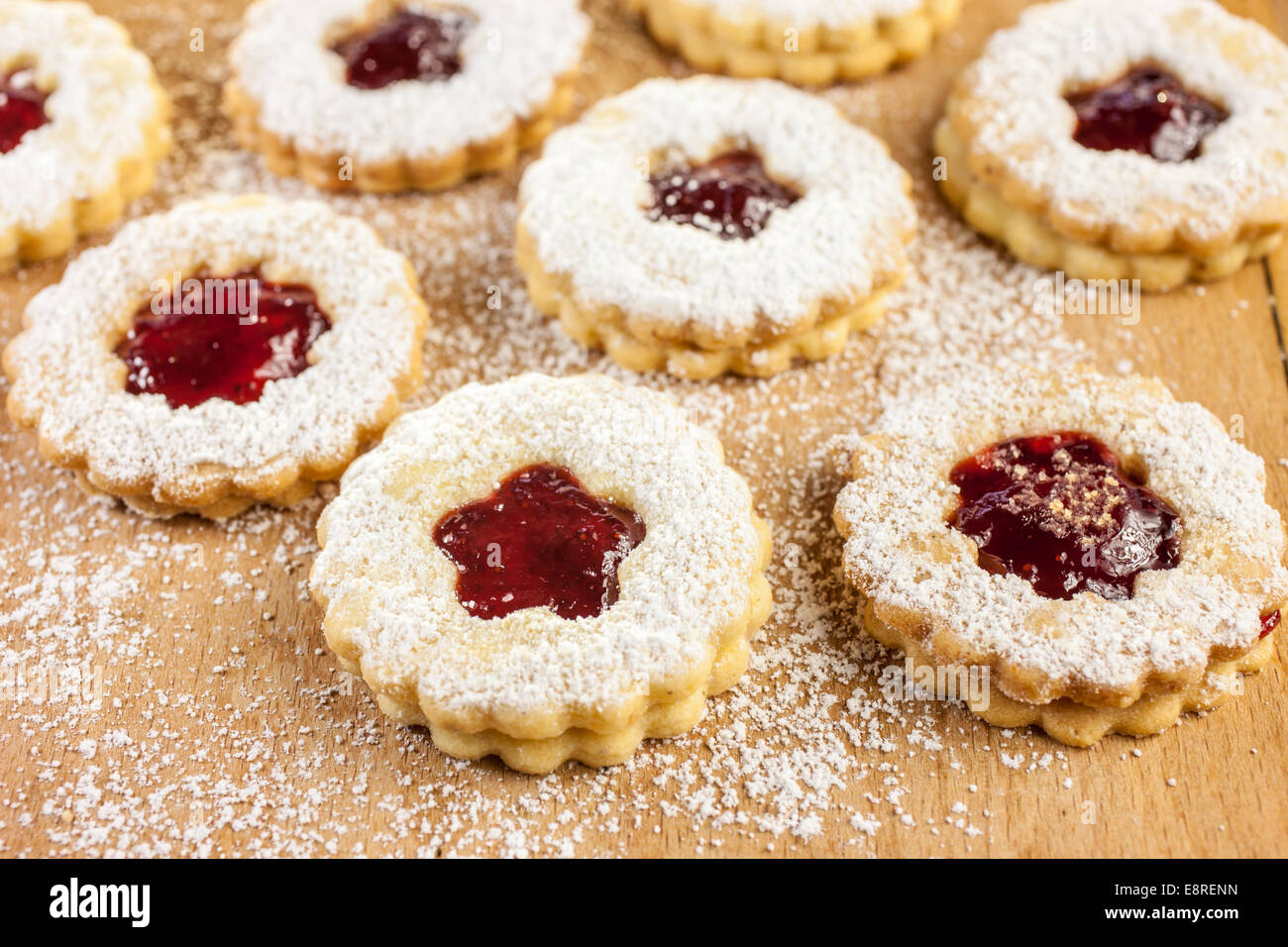 Christmas Cookies Filled With Jam On A Floured Table Stock Photo