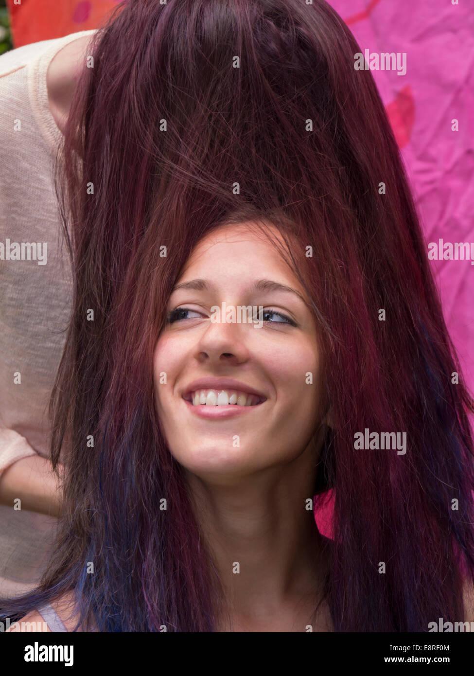 Girl teenagers hair fun - Stock Image
