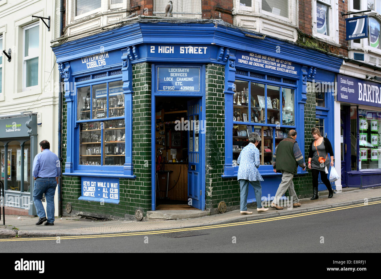 Traditional locksmith and cobblers shop, High Street, Lutterworth, Leicestershire. - Stock Image