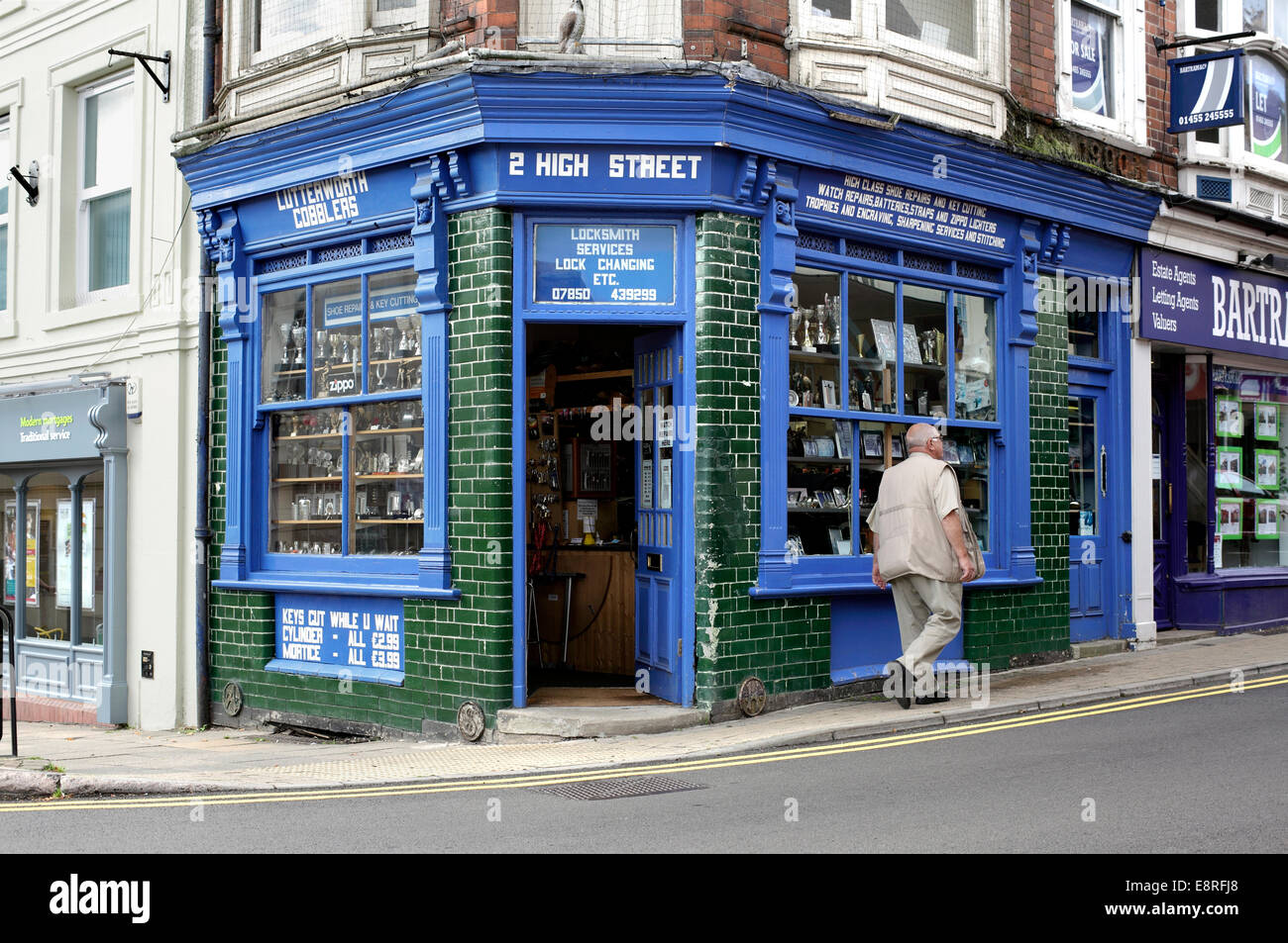 Traditional locksmith and cobblers shop, High Street, Lutterworth, Leicestershire. Stock Photo