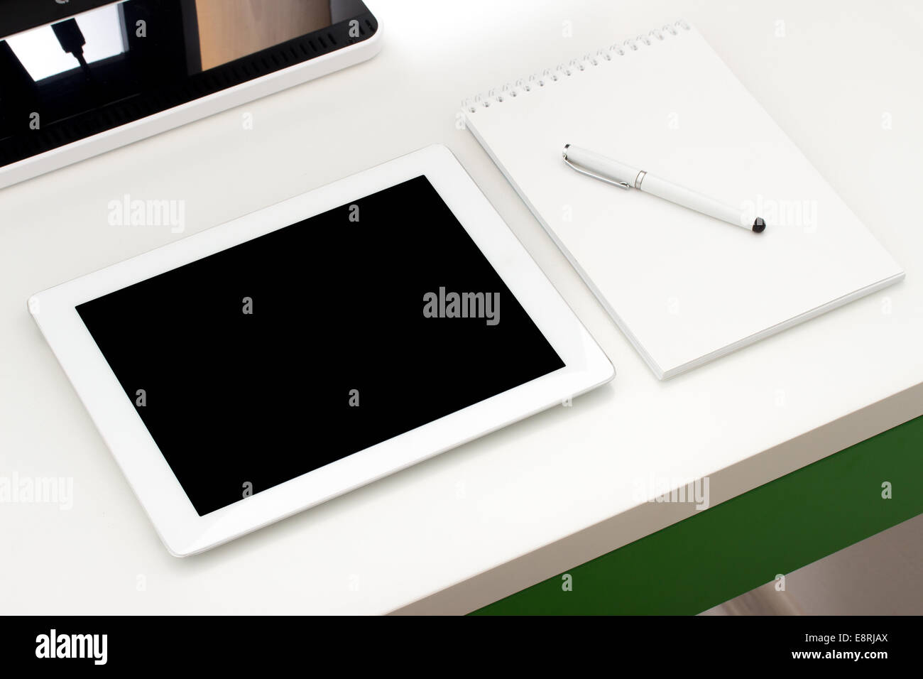 Workplace with tablet and keyboard, pen Stock Photo