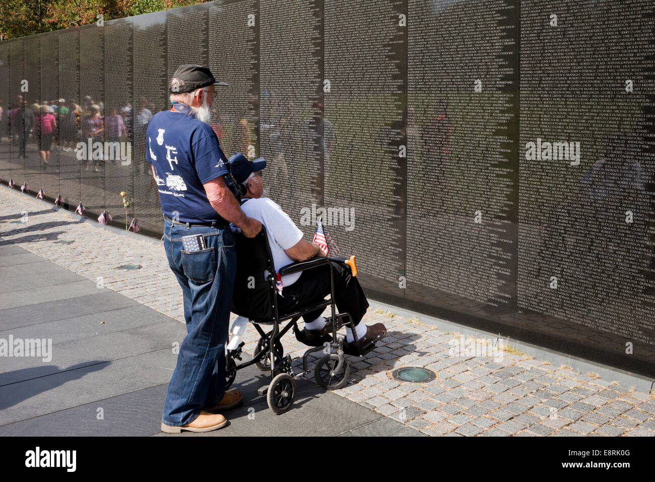 Veteran in wheelchair visiting Vietnam Veterans Memorial wall - Washington, DC USA - Stock Image