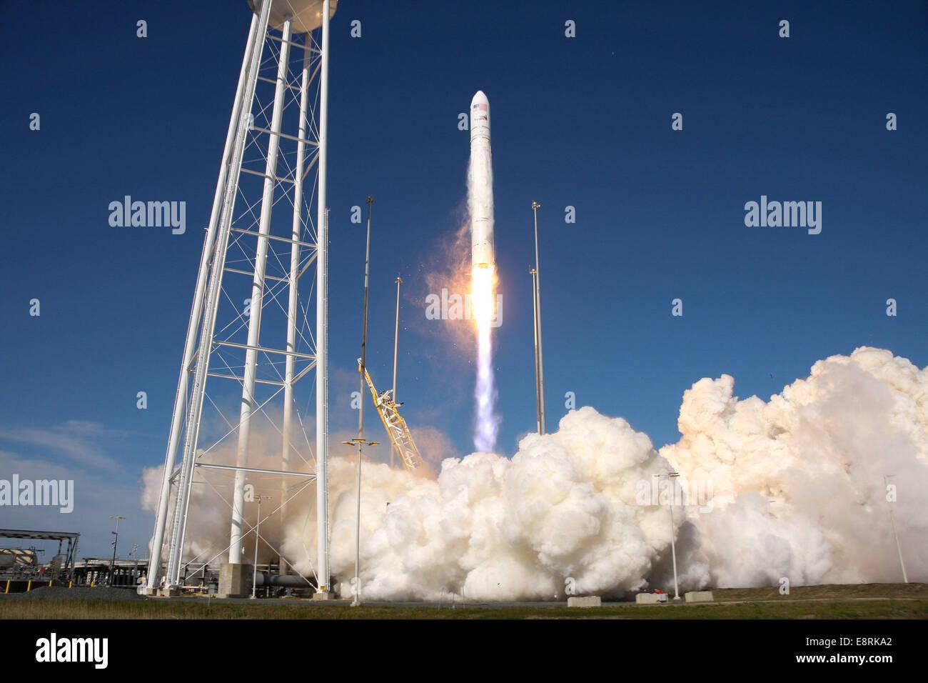 WALLOPS ISLAND, Va.--NASA commercial space partner Orbital Sciences Corporation launched its Antares rocket at 5 - Stock Image