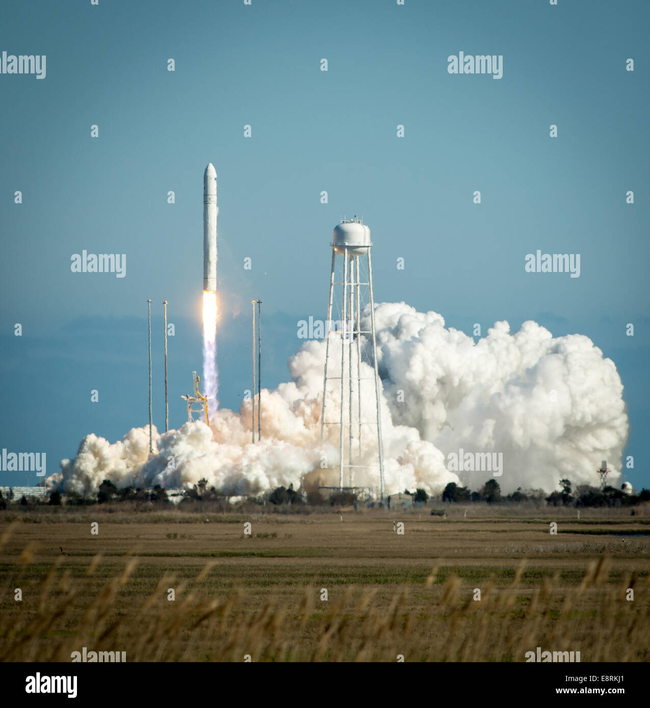 The Orbital Sciences Corporation Antares rocket is seen as it launches from Pad-0A of the Mid-Atlantic Regional - Stock Image