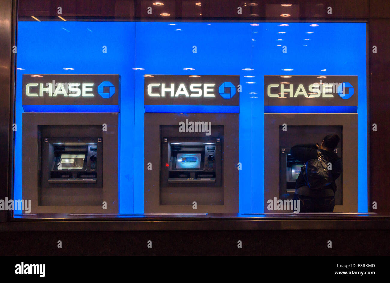 Customer uses the ATM machines at a JPMorgan Chase bank in New York on capital one bank, pnc bank, morgan chase bank, m&t bank, american express bank, jpm chase bank, td bank, crossland savings bank, call chase bank, goldman sachs bank, washington mutual bank, united kingdom retail bank, deutsche bank, nearest chase bank, wells fargo bank, suntrust bank, bmo harris bank, outdoor chase bank, bank of america bank, key bank,