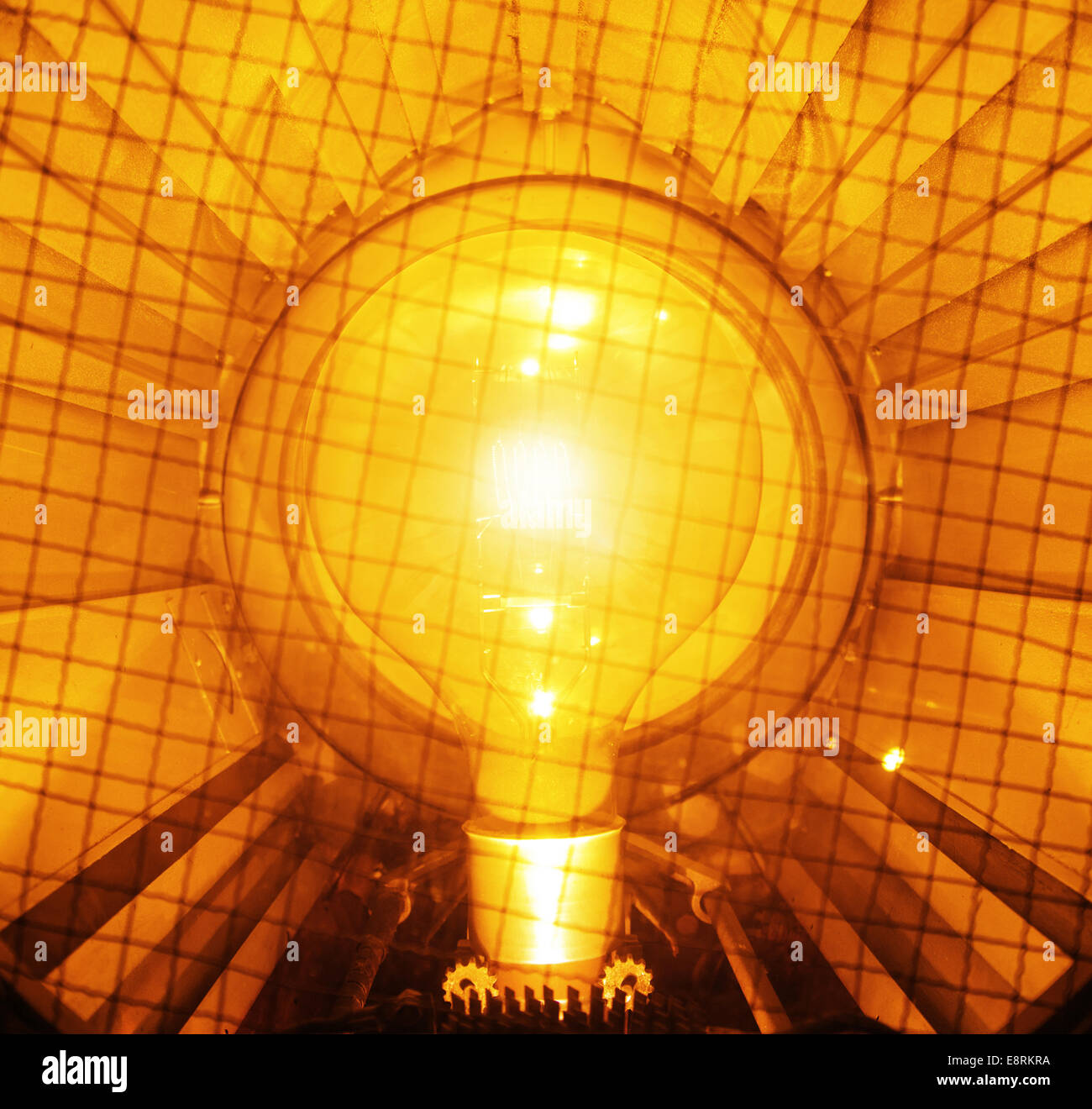 Bright and yellow light bulb - Stock Image