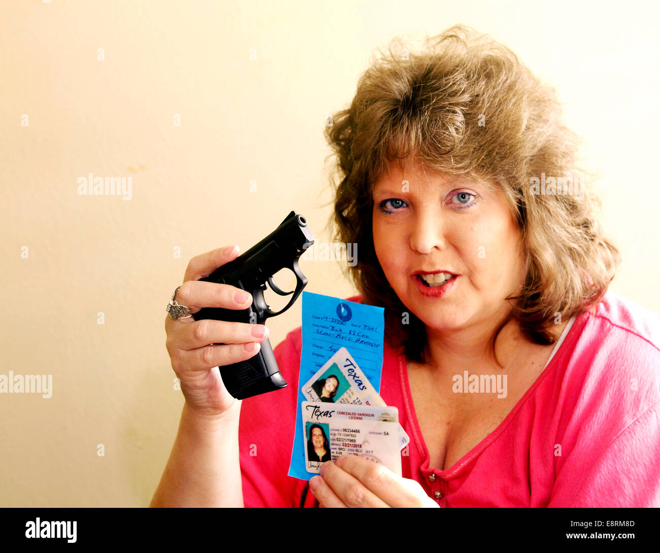 Woman in Texas has a permit for concealed handgun, but police still confiscated her hand gun. - Stock Image