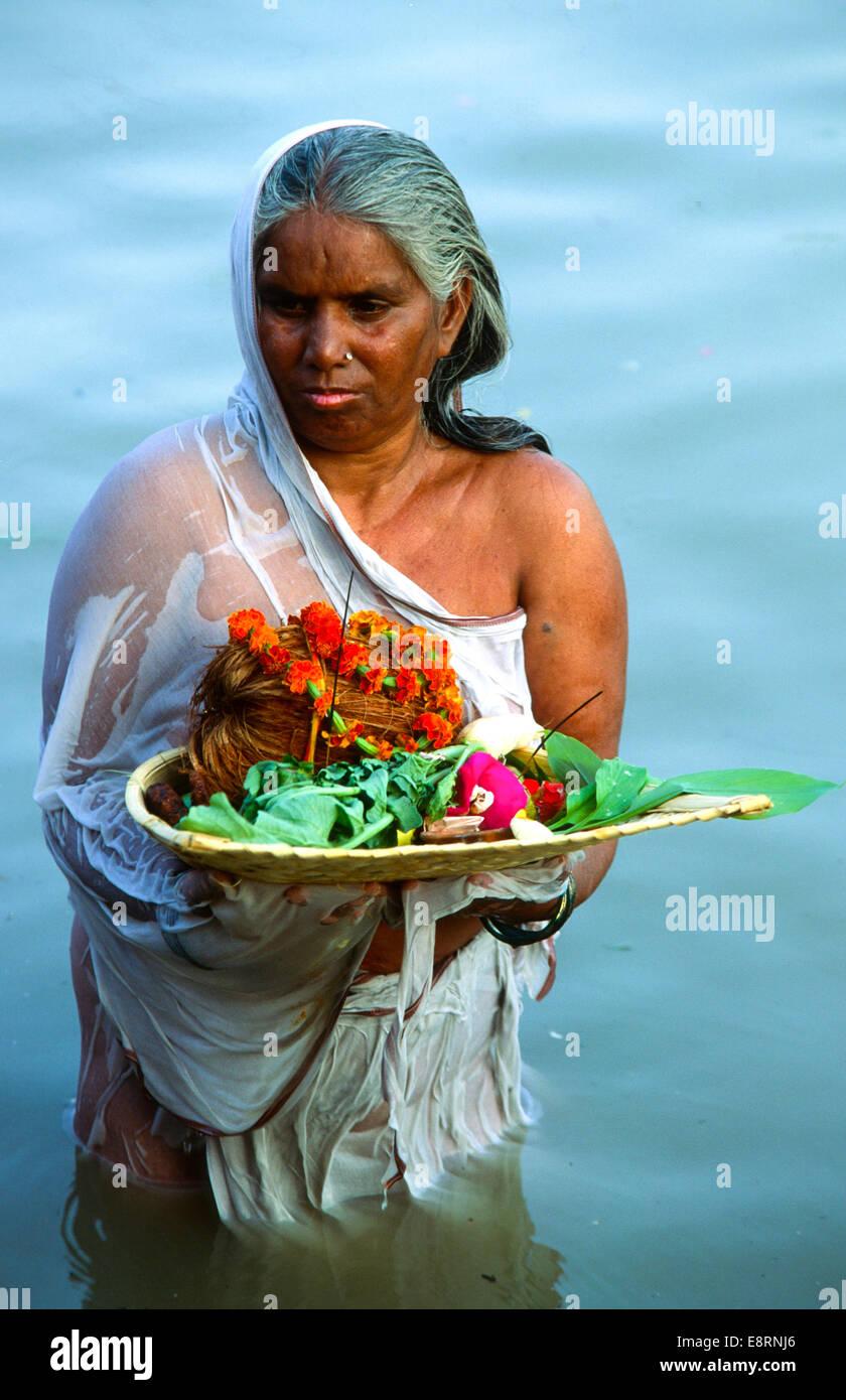 pregnant woman pray for boy in holy ganga river at varanasi