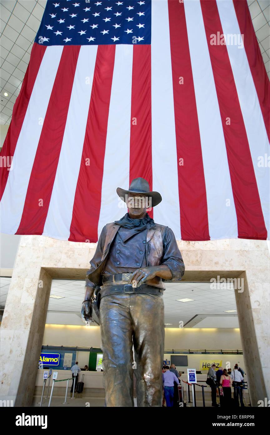 John Wayne statue at airport in Orange County, California - Stock Image