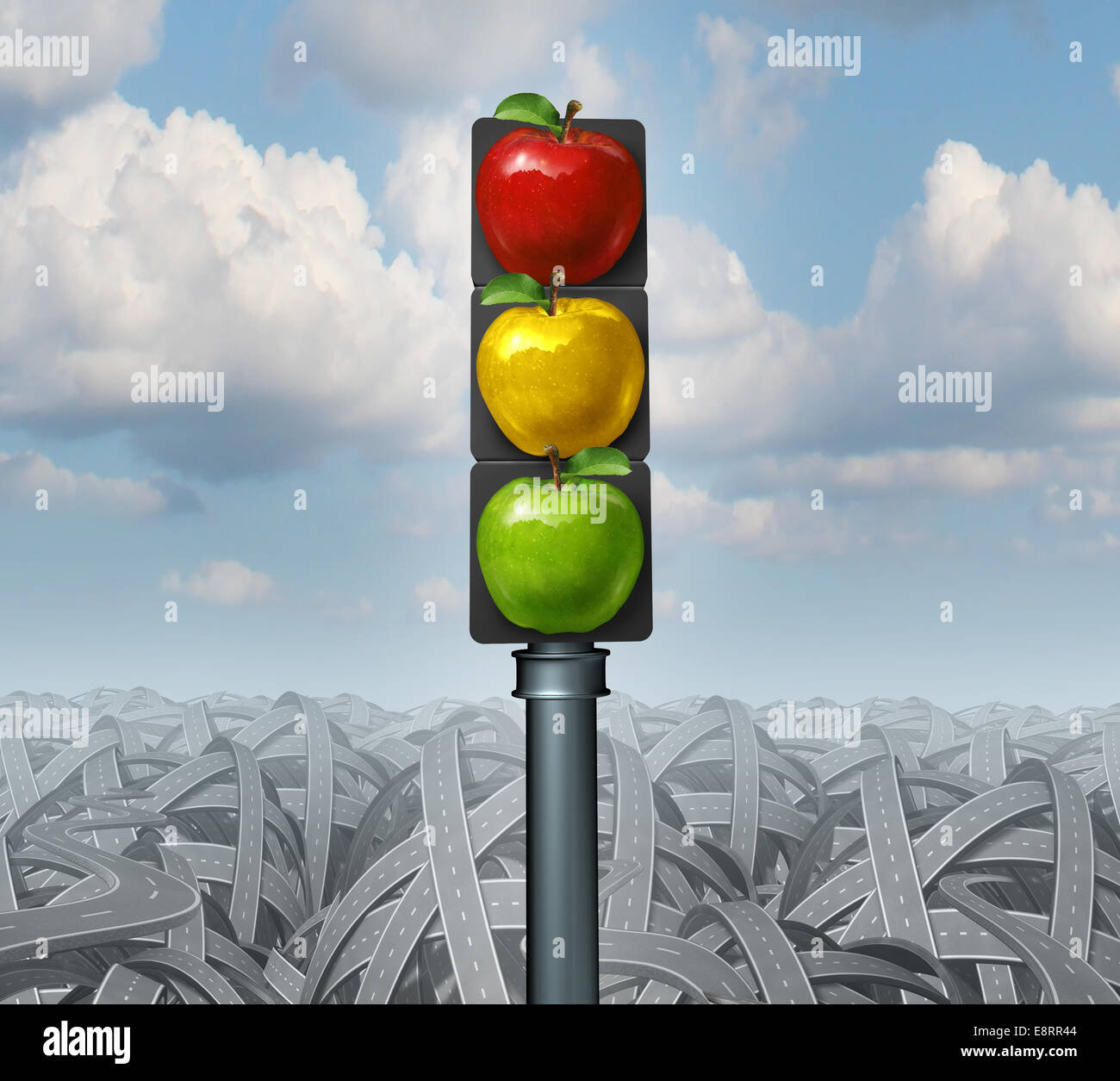 Healthy lifestyle advice and eat healthy concept as traffic lights with green yellow and red apples on a background - Stock Image