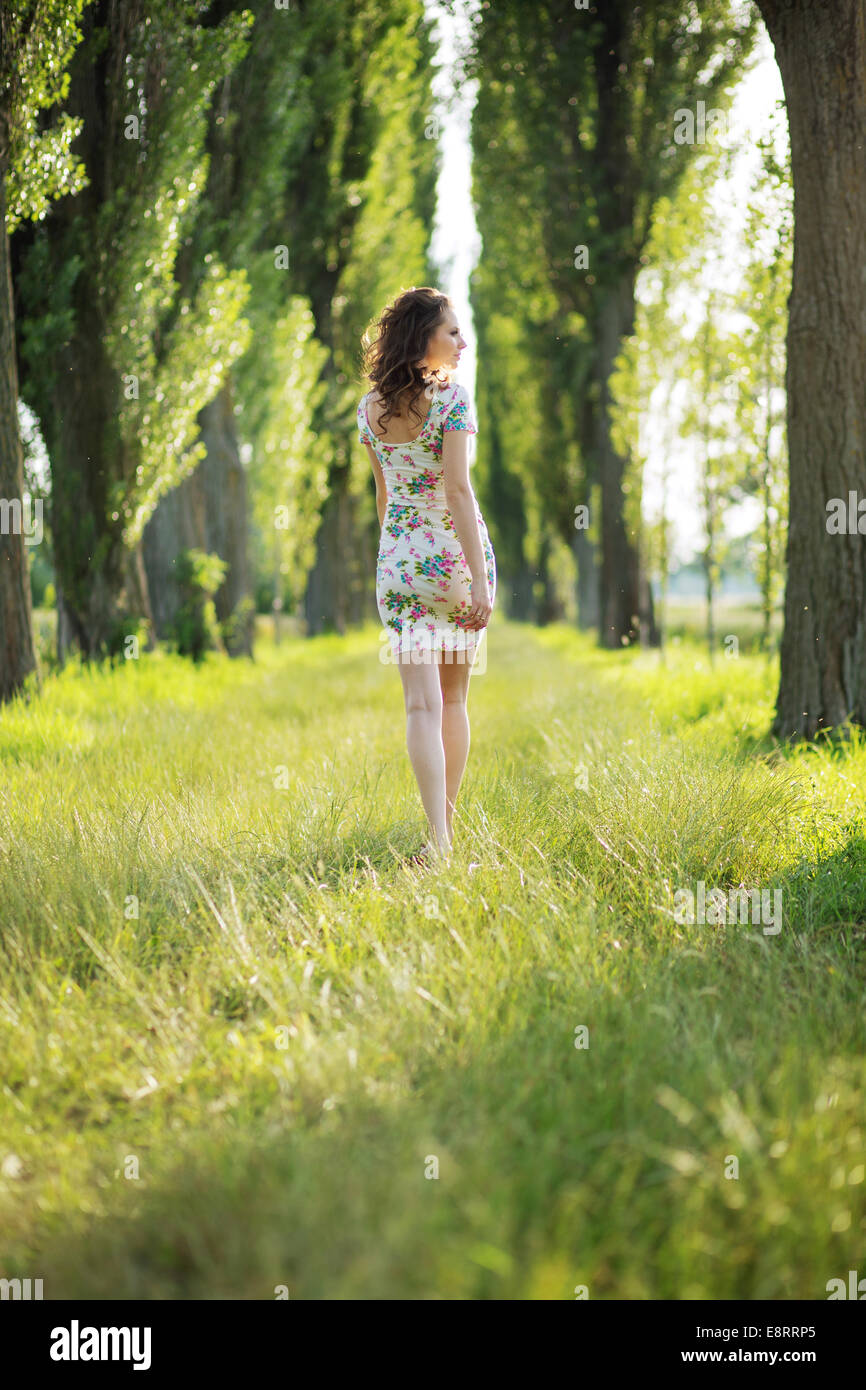Shapely pregnant woman in the green park - Stock Image