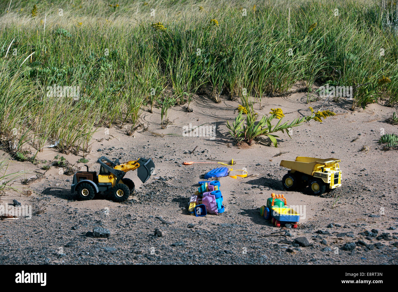 Toys left behind in the Sand - Covehead Harbour - York, Prince Edward Island, Canada - Stock Image