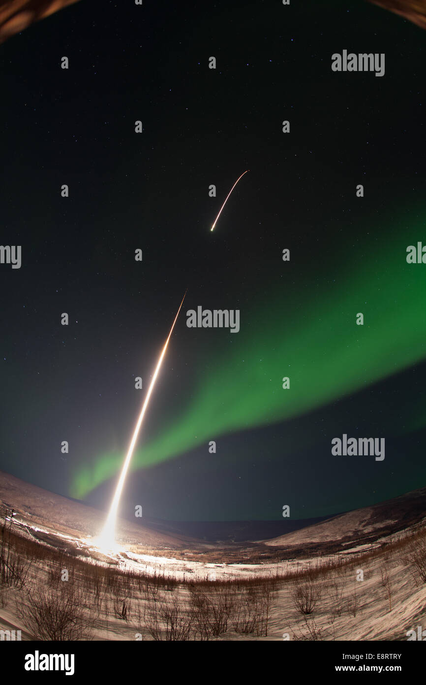 Caption: A NASA-funded sounding rocket launches into an aurora in the early morning of March 3, 2014, over Venetie, - Stock Image