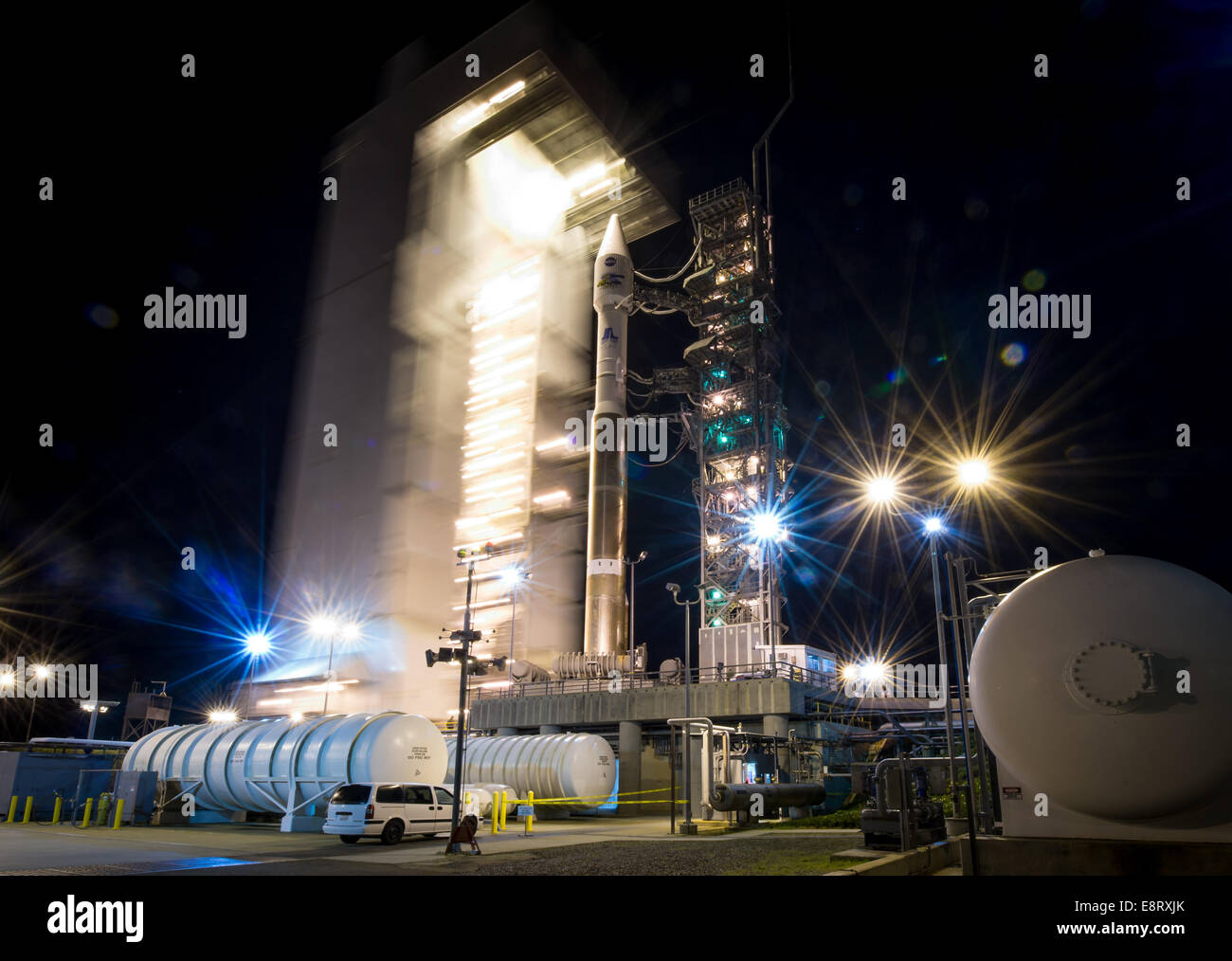 The launch pad tower at SLC-3 is rolled back to reveal the United Launch Alliance (ULA) Atlas-V rocket with the - Stock Image