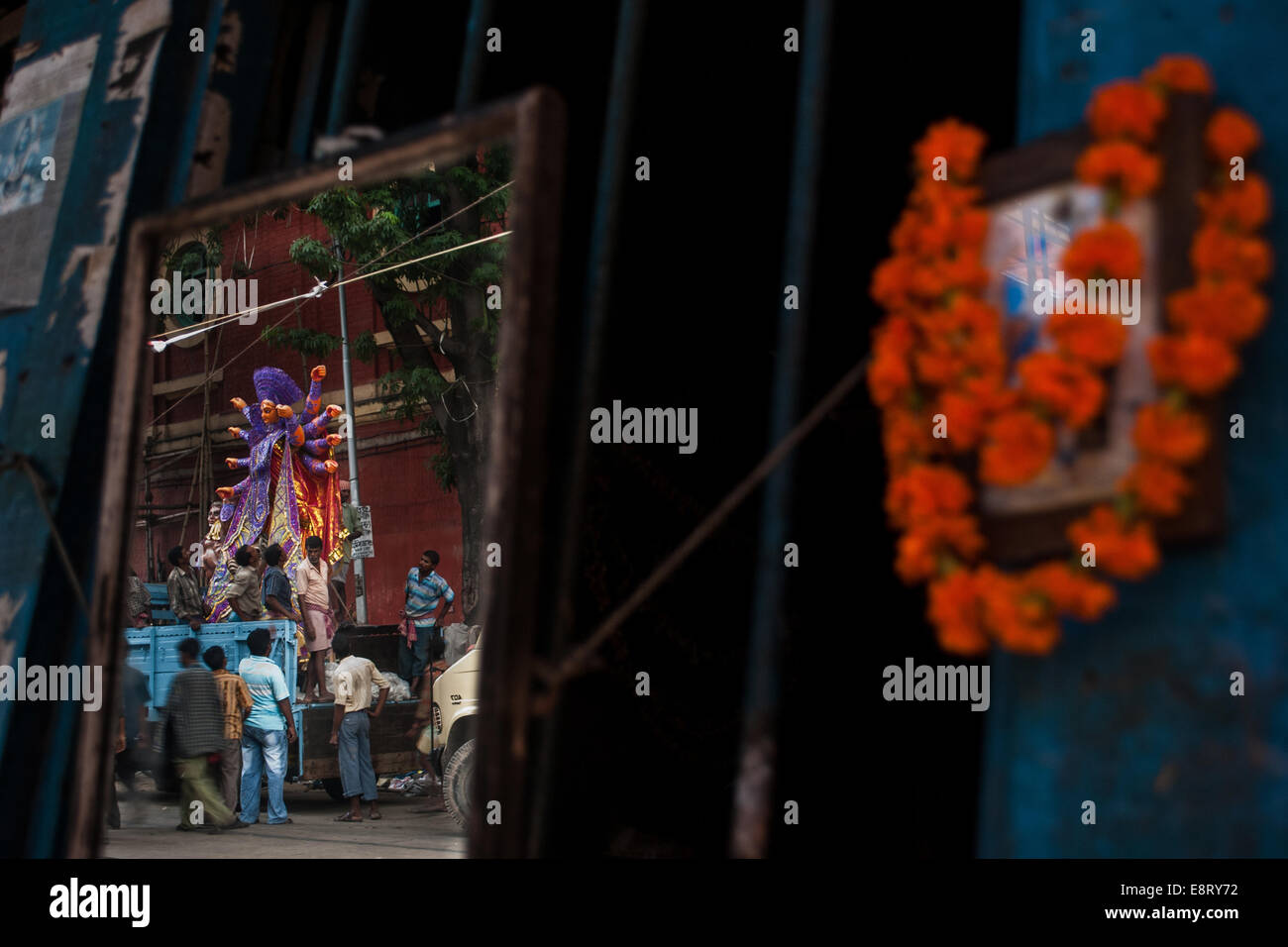 Hindu goddess Durga is reflect on a mirror,Kolkata,West Bengal,India - Stock Image