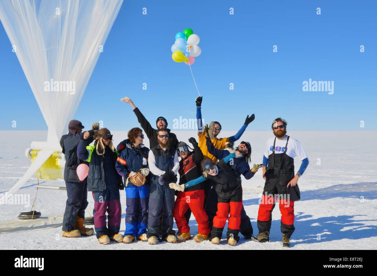 The BARREL team at the SANAE IV research station celebrates their final launch in the Antarctica sun. - Stock Image