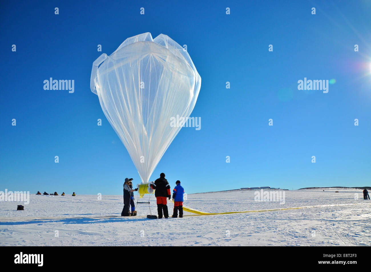 A BARREL balloon floats into the sky as it is partially filled. When fully inflated, each balloon is 90 feet in - Stock Image