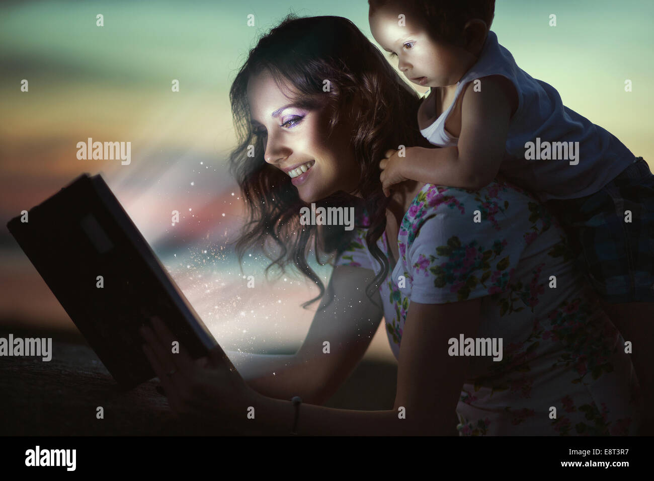 Mommy reading amazing book for her baby - Stock Image