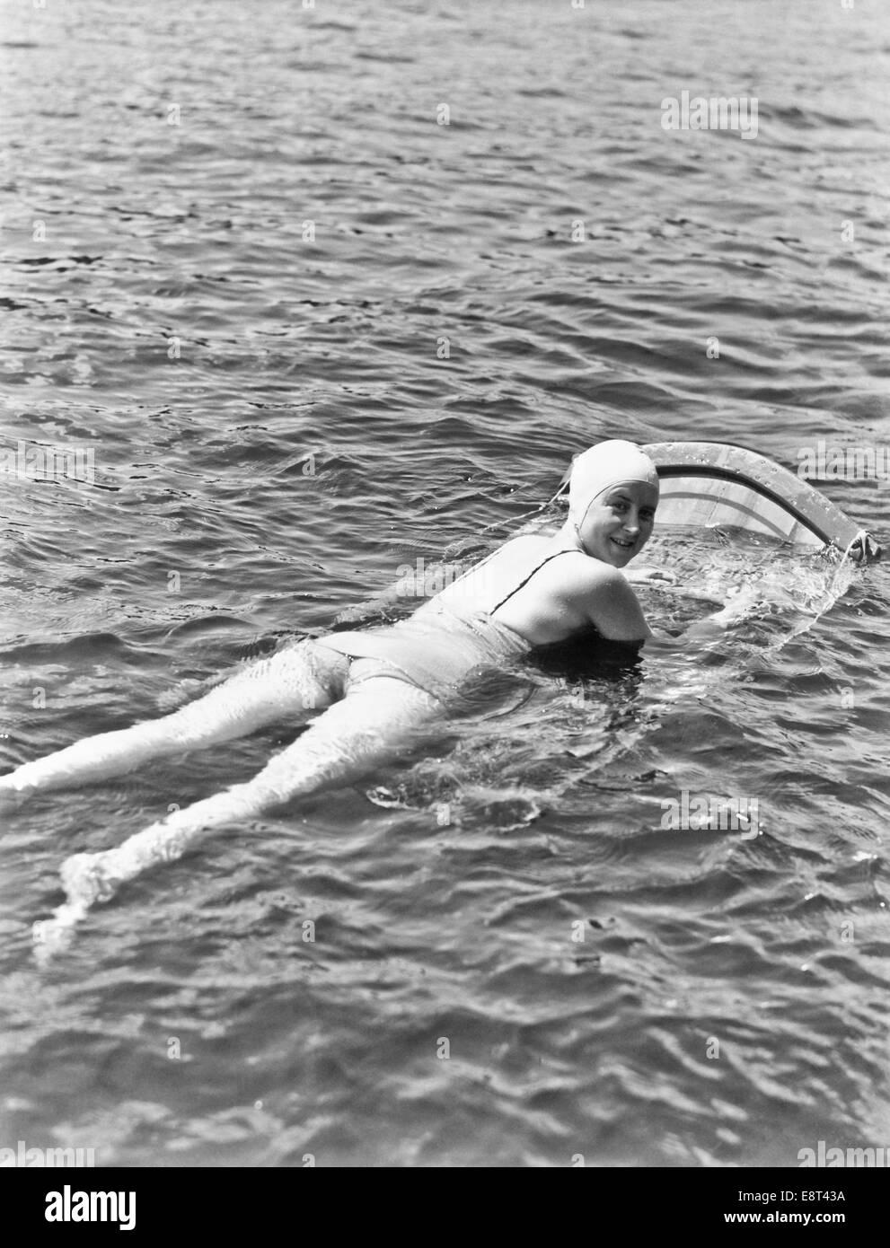 be972816c417e 1930s 1940s WOMAN WEAR BATHING CAP ONE PIECE SUIT LYING ON AQUA SKI BOARD  LOOK AT