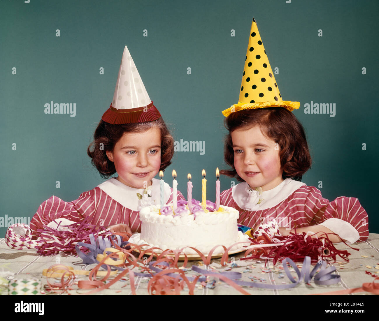 1960s Twin Girls Wearing Party Hats And Birthday Cake With Five