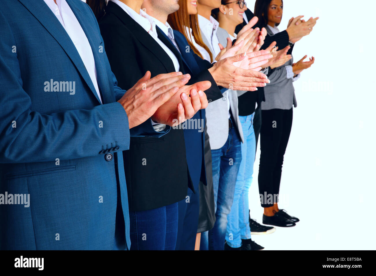 Group of business partners applauding - Stock Image