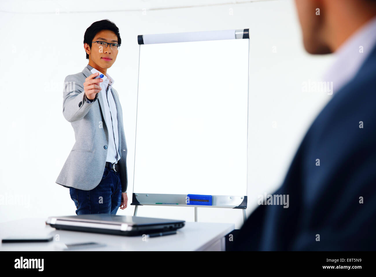 Portrait of a businessman presenting something on a meeting - Stock Image